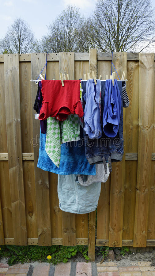 Laundry. Is hanging on a small clotheshorse in the garden stock image