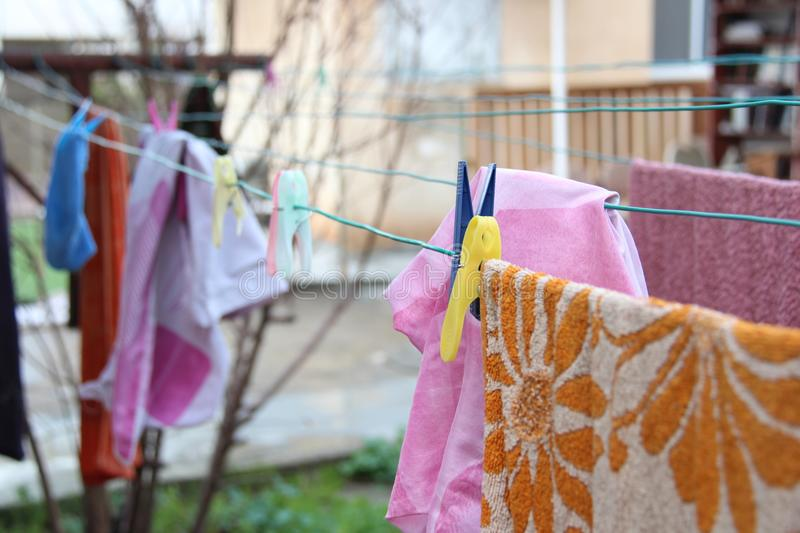 Laundry hangs on a rope in a yard stock photo