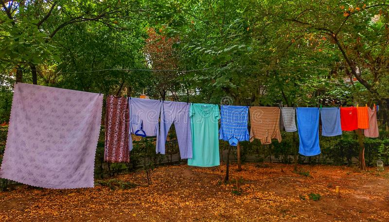 Laundry hung outside. Clothes, townscape, culture, romania, craiova, hang, outdoors, dryer, nature, trees, blocks, neighborhood, locals stock photo