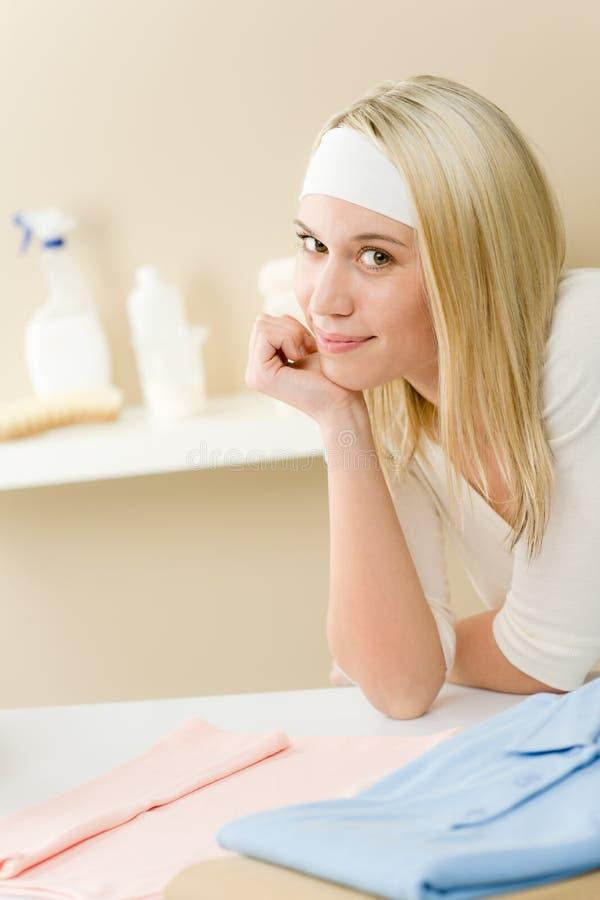 Laundry ironing - woman break after housework stock image