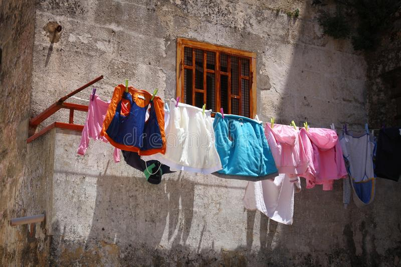 Laundry in Italy. Matera, Italy. Colorful laundry in Sassi districts stock image