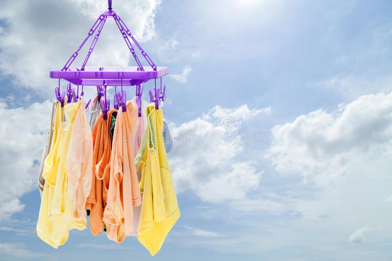 Laundry line with baby clothes on blue sky background. Laundry line with baby clothes on blue sky background royalty free stock photos