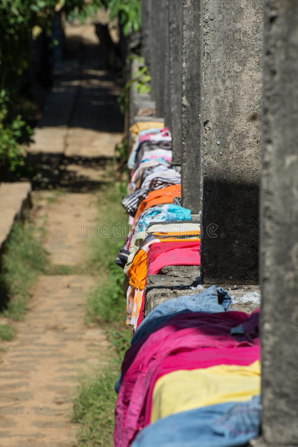 Laundry. Madagascar, as the women spread the laundry on the ground stock photography