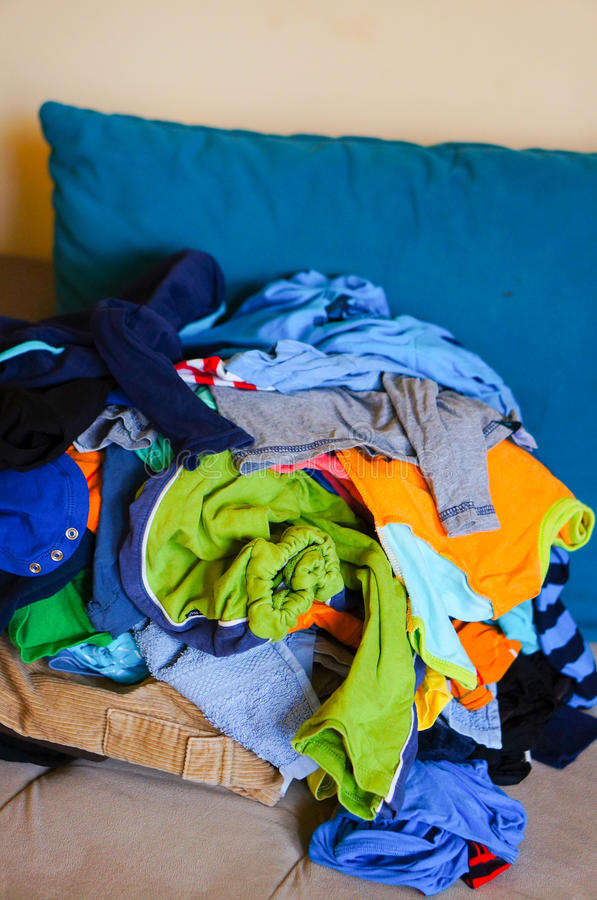Laundry pile. Pile of clean laundry on sofa stock images