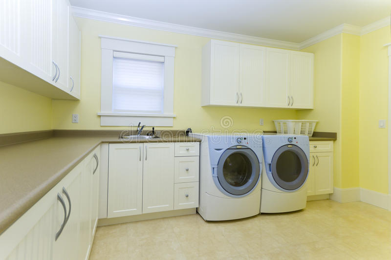 Download Laundry room stock photo. Image of basket, washer, cabinet - 16723988