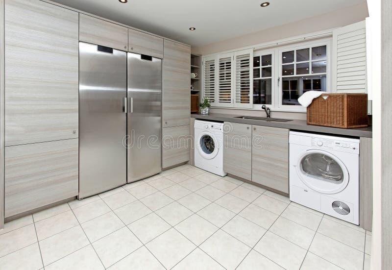 Laundry room. Modern laundry room inside big kitchen interior