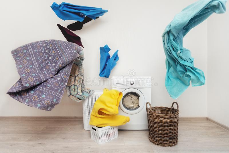 Laundry room interior with washing machine near wall. Concept of funky and easy laundry process. White washing machine standing inside flat with bright interior royalty free stock image
