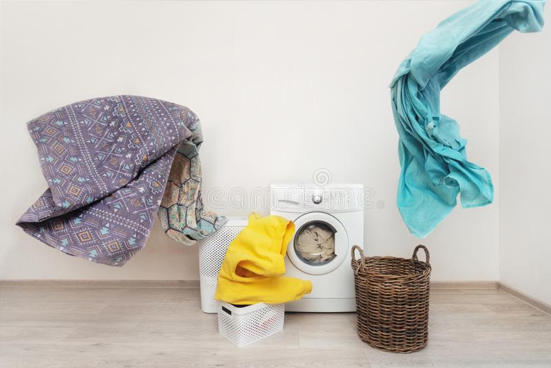 Laundry room interior with washing machine near wall. Concept of happy and easy laundry process. New modern washing machine standing inside bright apartment stock photo