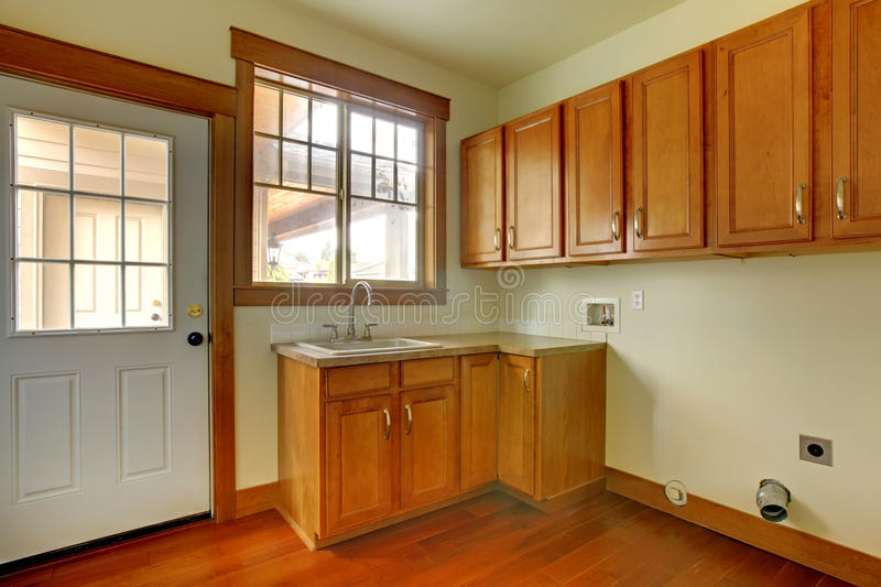Laundry room with sink. New luxury home interior. stock image