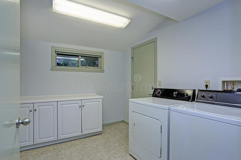 Laundry room with vaulted ceiling stock images