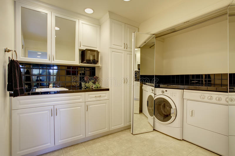 Folding Doors For Laundry Room : Laundry room with washer dryer and miror folding doors