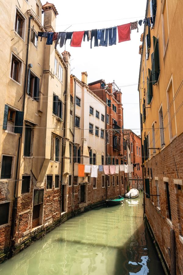 Laundry hanging out to dry on ropes over canal, Venice, Italy royalty free stock images