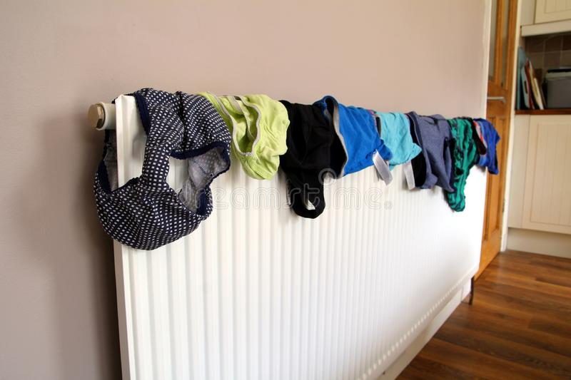Laundry or washing drying on a domestic radiator.  stock photos