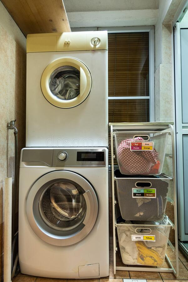 Laundry for washing sorted in group of fabric colors in basket stock photos