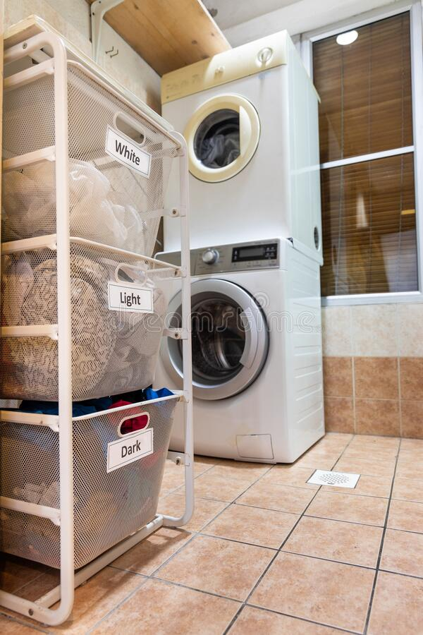 Laundry for washing sorted in group of white, light and dark in basket royalty free stock photo