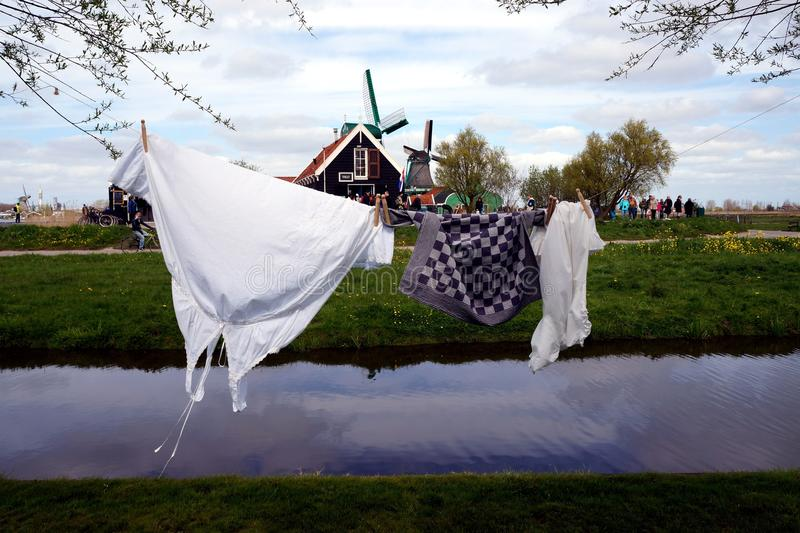 Laundry and windmills. Laundry in Zaanse Schans ethnographic museum in Netherlands royalty free stock photo