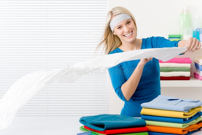 Laundry - Woman Folding Clothes Royalty Free Stock Photos