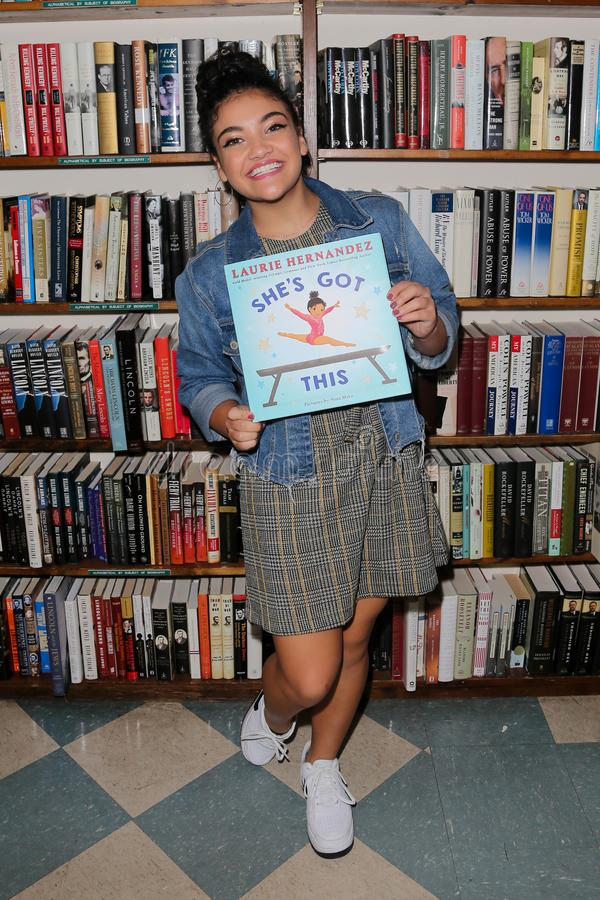 Laurie Hernandez. HUNTINGTON, NY - OCT 11: Olympian Laurie Hernandez signs copies of her book `She`s Got This` at Book Revue on October 11, 2018 in Huntington stock photography