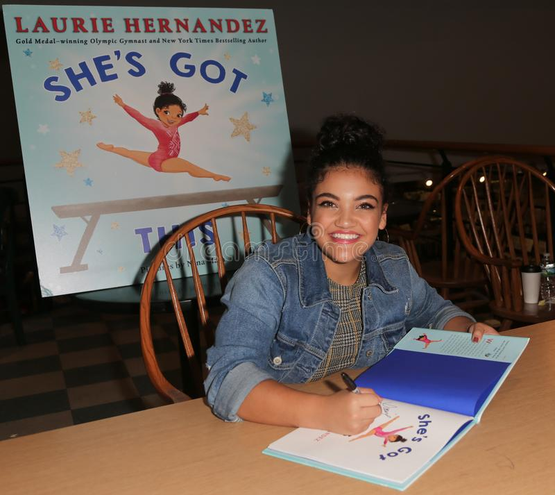 Laurie Hernandez. HUNTINGTON, NY - OCT 11: Olympian Laurie Hernandez signs copies of her book `She`s Got This` at Book Revue on October 11, 2018 in Huntington stock photos