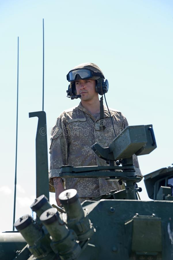 LAV crew member stand tall at NZ army open day stock photography