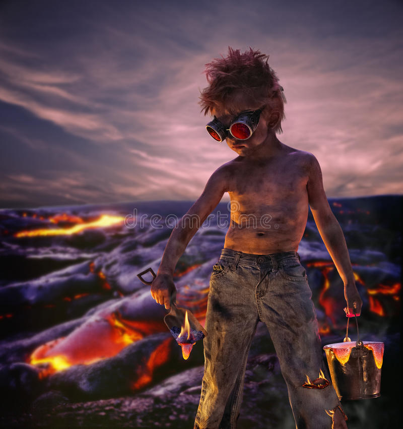 Lava Boy. Small boy digging up lava standing in a lava flow royalty free stock photography