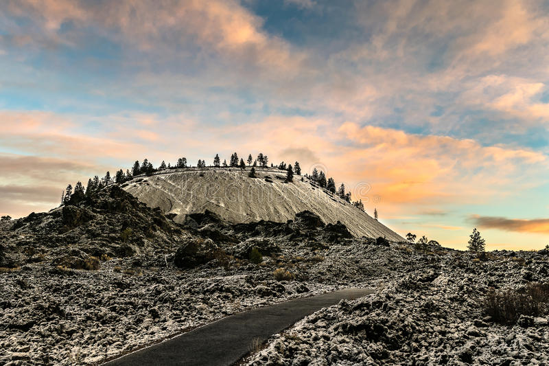 Lava Butte Sunrise. Lava Butte at Newberry National Volcanic Monument with a fresh dusting of early winter snow royalty free stock images