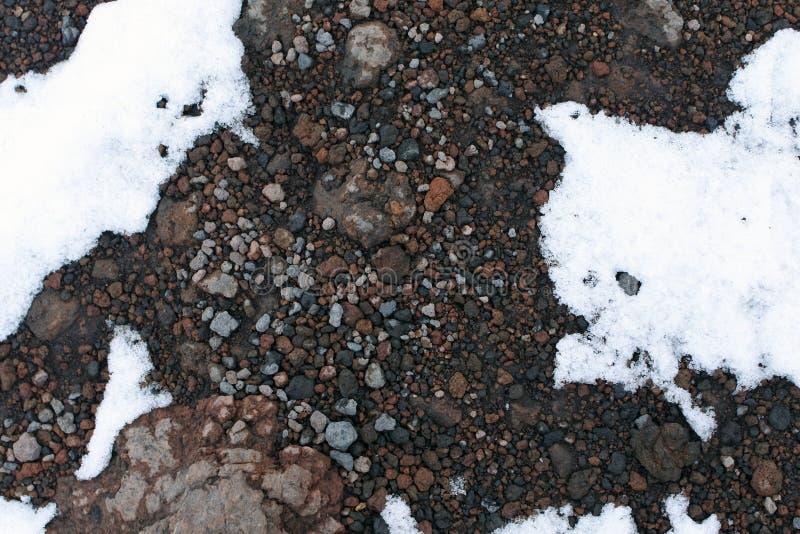 Lava endurecida debajo de la nieve superficie del monte Etna fotografía de archivo libre de regalías