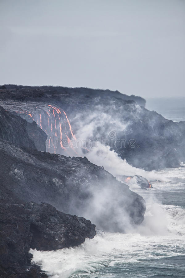 Lava erupting into Pacific Ocean in Hawaii. Big Island stock photography