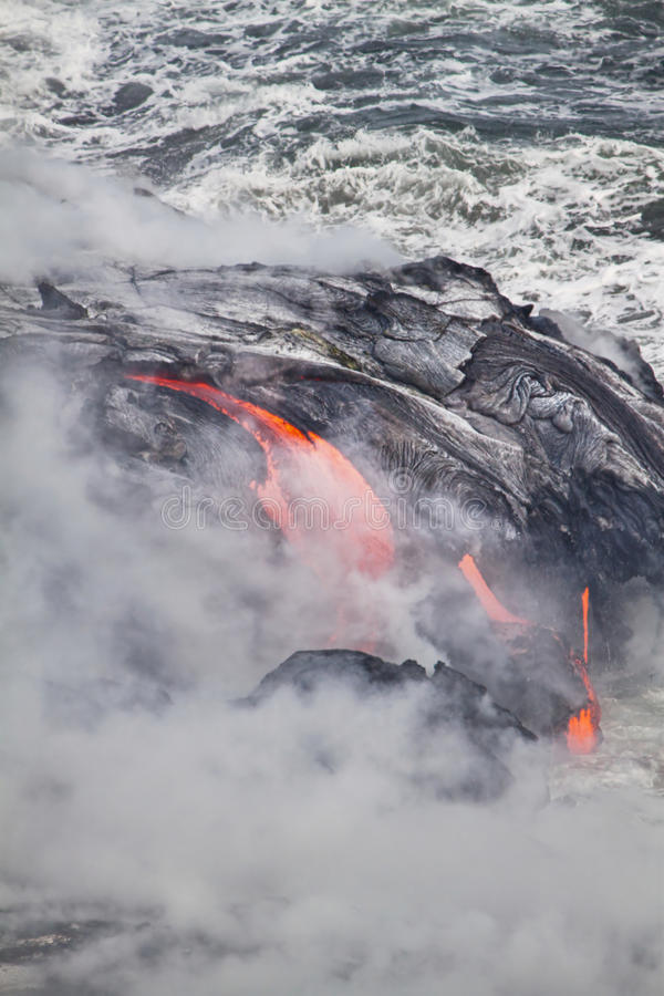 Lava erupting into Pacific Ocean in Hawaii. Big Island royalty free stock photography