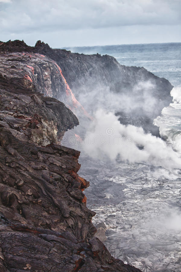 Lava erupting into Pacific Ocean in Hawaii. Big Island royalty free stock images