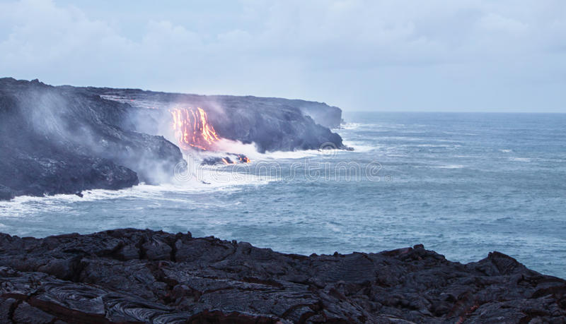 Lava erupting into Pacific Ocean in Hawaii. Big Island stock images