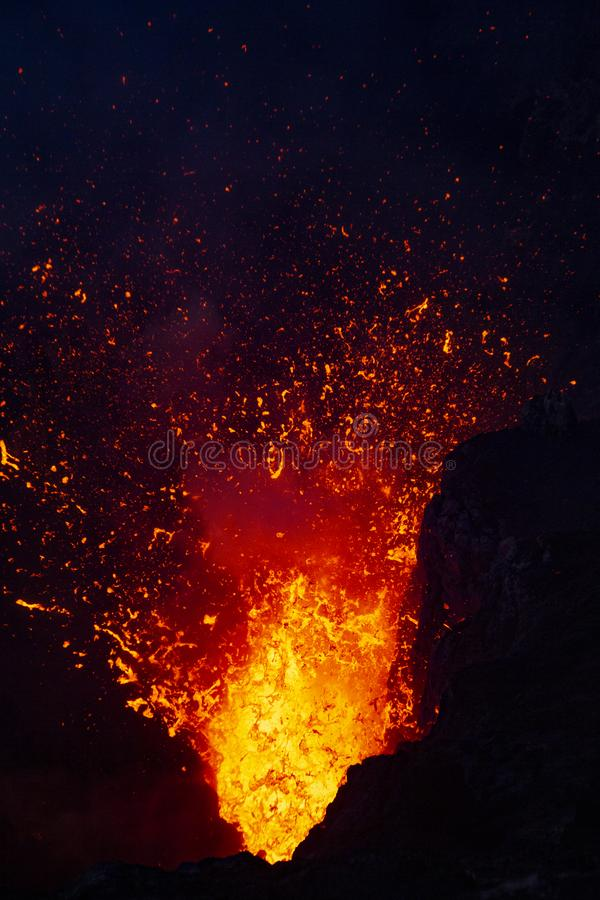 Lava explodes stock images