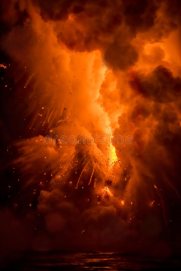 Lava explosion in Hawaii. A lava flow on the big Island of Hawaii known as the fire hose spews out molten magma from Kilauea Volcano into the ocean, causing stock photos