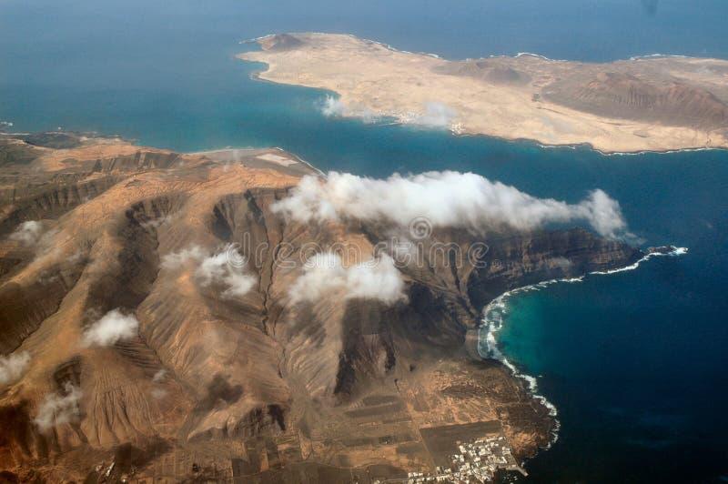 Lava field and volcano coast stock photos