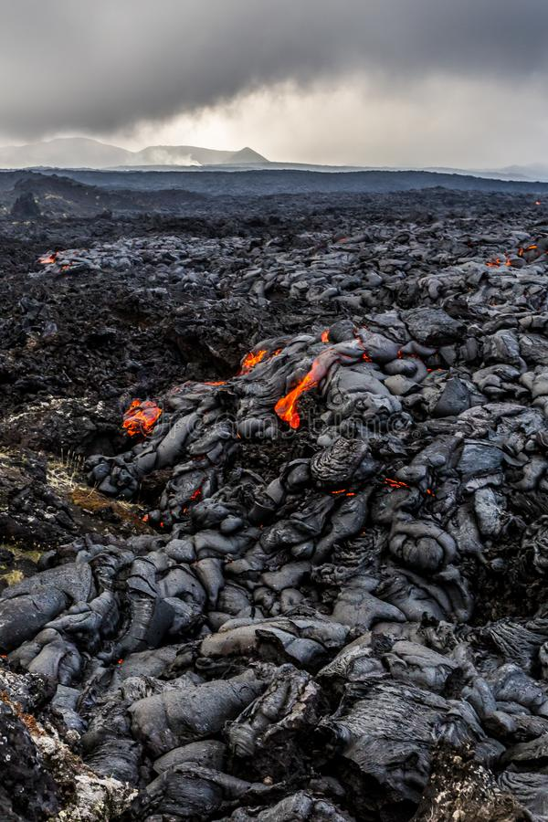Lava fields near erupting volcano Tolbachik at night, Kamchatka Peninsula, Russia. Volcanic landscape royalty free stock images
