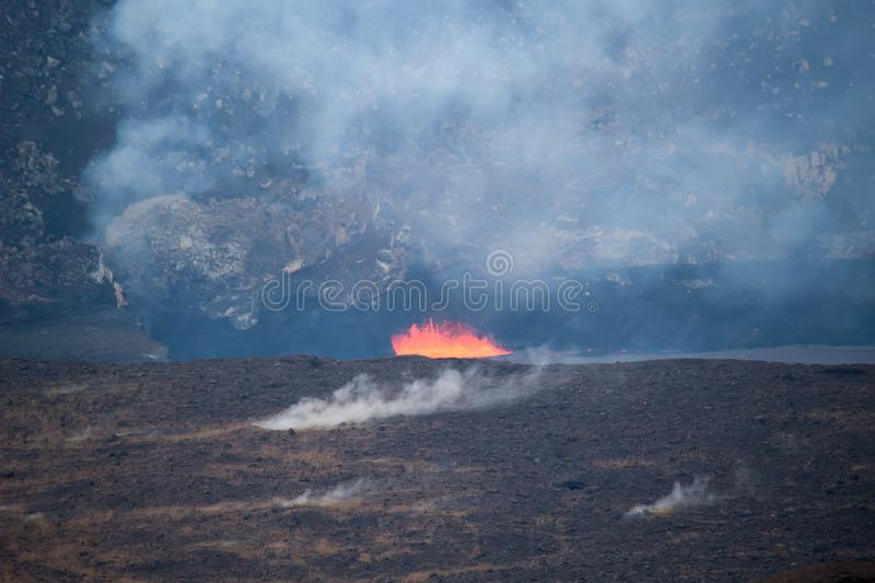 Lava flaw in a crater volcano. Lava flaw in volcano crater on a Big Island, Hawaii, USA royalty free stock image