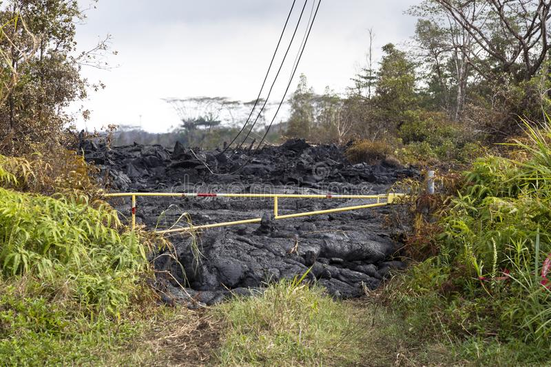Lava flow in Hawaii, which has just stopped in front of a barrier stock photography