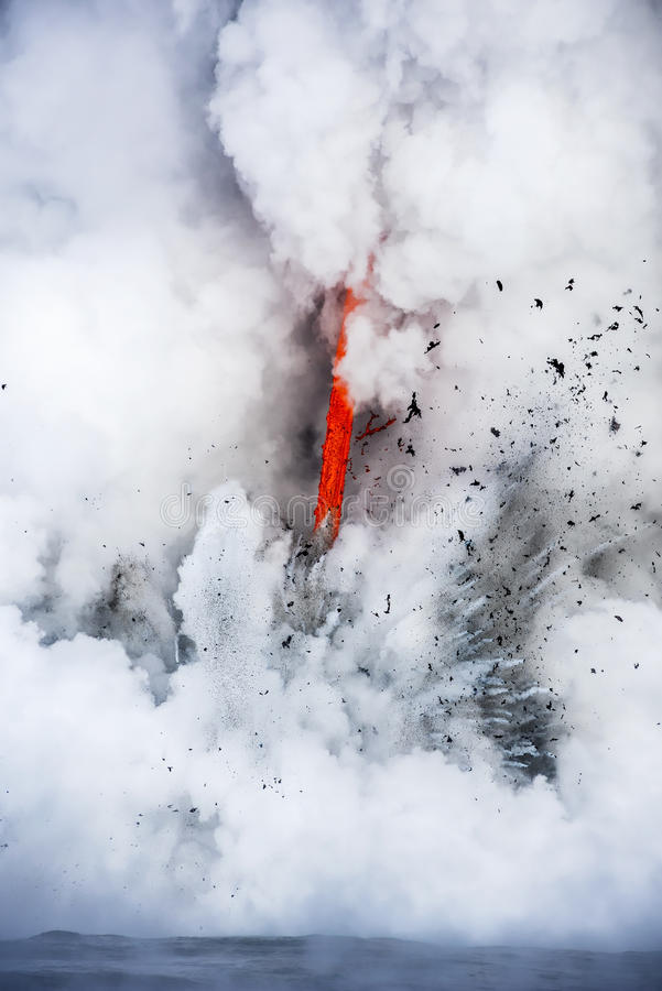 Lava flow into ocean. A lava flow on the big Island of Hawaii known as the fire hose spews out molten magma from Kilauea Volcano into the ocean, causing stock image
