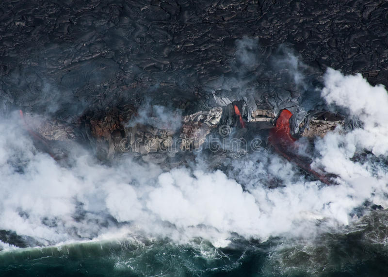 Lava Flowing into Ocean stock photography