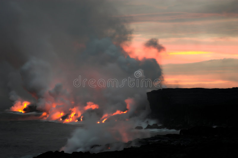 Lava flowing into the ocean. Lava erupting into Pacific Ocean at night on Big Island stock images