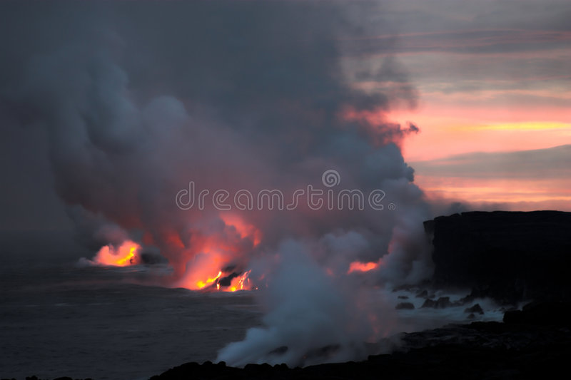 Lava flowing into the ocean. Lava erupting into Pacific Ocean at night on Big Island stock photography