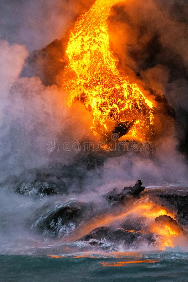 Lava Flowing into the Ocean in Hawaii royalty free stock images