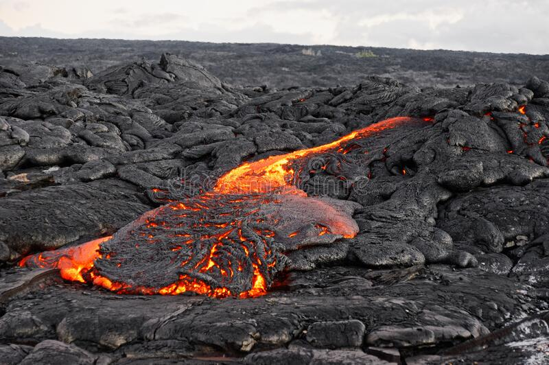 Lava flows out of a fissure royalty free stock photography