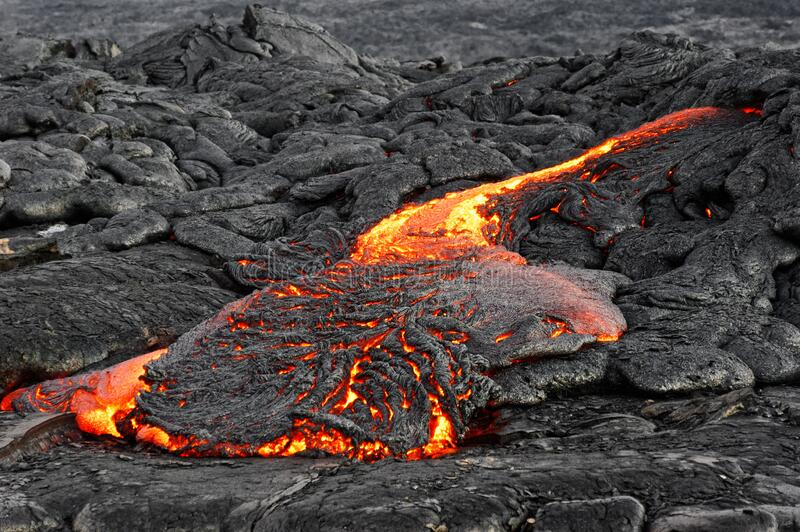 Lava flows out of a fissure royalty free stock image