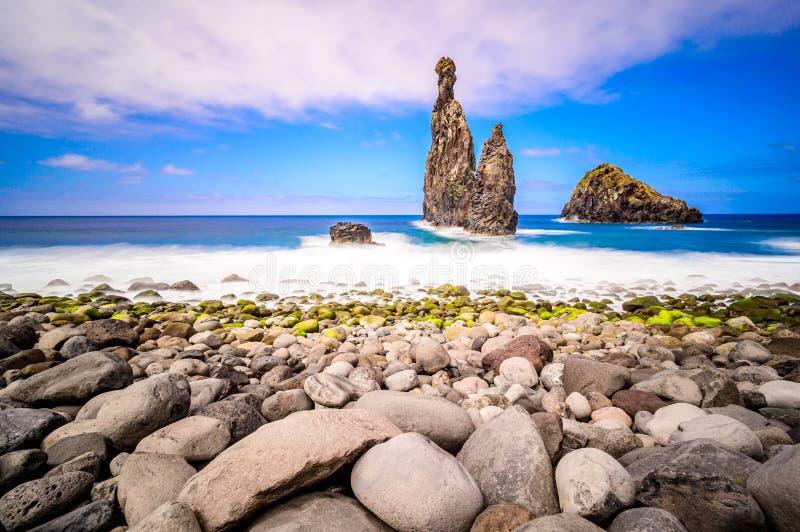 Lava islets in Ribeira da Janela at stony beach - Wild and beautiful coast with rock formations in the ocean near Porto Moniz on. The island Madeira, Portugal royalty free stock image