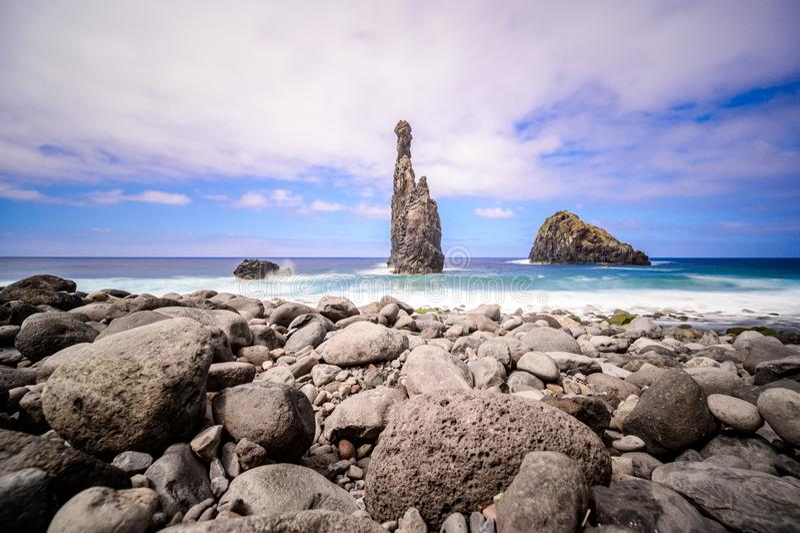 Lava islets in Ribeira da Janela at stony beach - Wild and beautiful coast with rock formations in the ocean near Porto Moniz on. The island Madeira, Portugal royalty free stock photography
