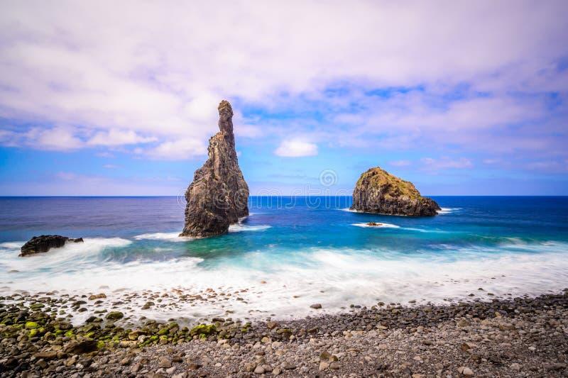 Lava islets in Ribeira da Janela at stony beach - Wild and beautiful coast with rock formations in the ocean near Porto Moniz on. The island Madeira, Portugal royalty free stock photo