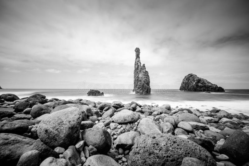 Lava islets in Ribeira da Janela at stony beach - Wild and beautiful coast with rock formations in the ocean near Porto Moniz on. The island Madeira, Portugal stock image