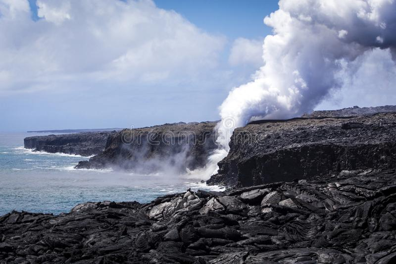 Lava from Kilauea pouring to the ocean stock photos