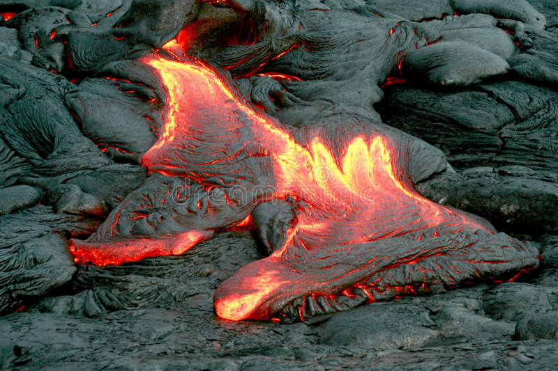 Lava Outbreak. Lava spills forth from Kilauea Volcano on Hawaii stock images
